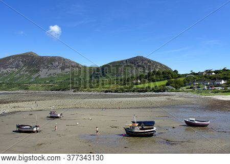 Trefor, Caernarfon / Wales / July 20 2020 : The Beach At The Small Harbor Of The Village Of Trefor,