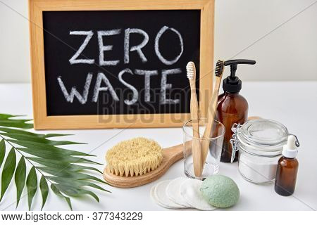 beauty, sustainability and eco living concept - natural cosmetics, bodycare, hygienic eco products and chalkboard with zero waste words or lettering on white background