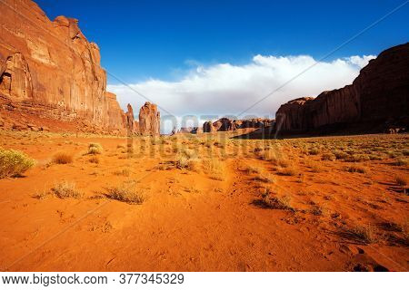 Monument Valley is a unique geological formation. The USA. Huge masses of red sandstone - outliers on the Navajo Indian Reservation. The concept of active and photo tourism