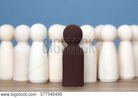 A Diversity Concept Of A Black Leader Or Manager Standing In Front Of His Team Of Employees In A Pos