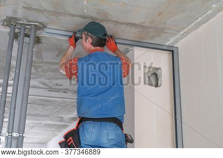 A Worker Makes A Wall Out Of Drywall