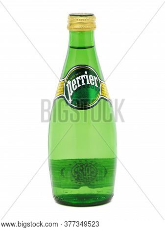 Bucharest, Romania - August 13, 2015. Bottle Of Perrier Sparkling Natural Mineral Water, Fortified W