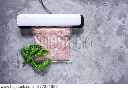 Marinating Meat Using Technology Sous Vide In A Vacuum Bag.