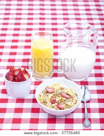 Breakfast Of Cereal, Fruit, Orange Juice And Milk