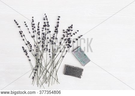Handmade Soap Bars With Natural Organic Ingredients, Dried Lavender Flowers On White Wood Table With