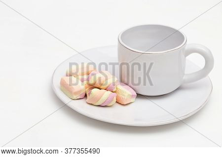 White Cup Of Coffee And Sweets On Table. Dessert For Breakfast. Copy Space.