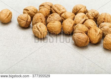 Food Background. Heap Of Walnuts Lie On Natural Cotton Surface. Soft Focus. Fresh Walnuts On Sackclo