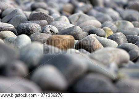 (selected Focus) Pattern Of Round Pebble Stone. Background Of The River Rock Pebbles.