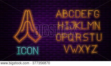 Glowing Neon Line Hands In Praying Position Icon Isolated On Brick Wall Background. Prayer To God Wi