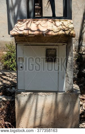 Electric Meter Box With A Tiled Roof