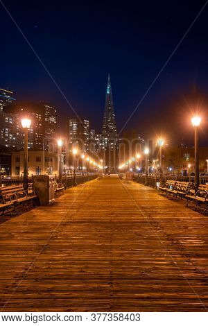 San Francisco downtown cityscape skylines and skyscrapers building from pier at night in California, USA. San Francisco United States Landmark Travel Destination cityscape urban and tourism concept.