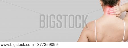 Girl Holds Hand Near Neck. Back View. Female Head And Shoulder. Home Self-massage. Young Woman Arm.