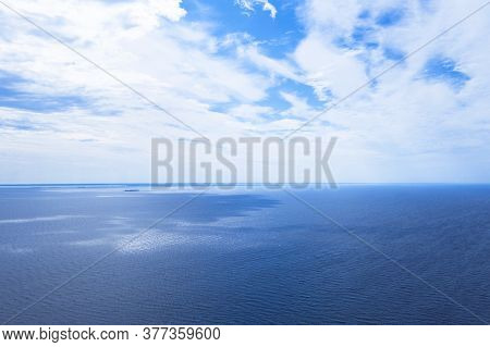 Aerial View Of A Blue Sea Water Background. Drone View. Waves Water Surface Texture. Aerial Fly Over