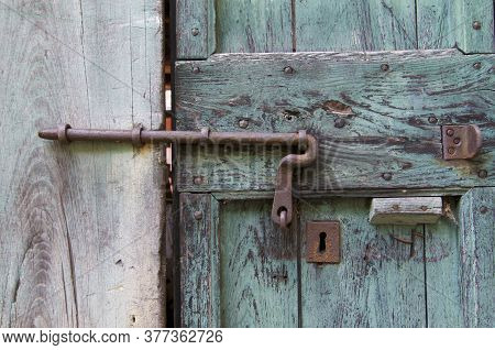 Close Up Of An Old Bold On A Turquoise Wooden Door Taken In The Village Center Of Bigorio In The Cap