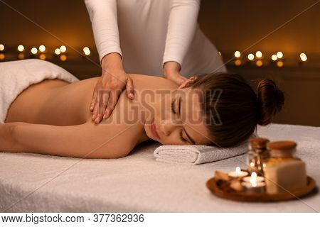 Woman Having Body Massage And Aromatherapy Session At Newest Spa