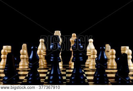Lateral View Of Chess Pieces On A Wooden Chess Board