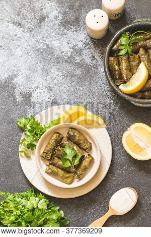 Dolma - Stuffed Greek Wine Leaves (dolmades) On Gray Concrete Background
