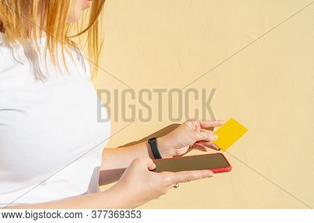 Woman Using Finger Print Signature System To Make Secure Verification On Her Smart Phone With Her Cr