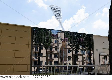 Minsk, Belarus - June 29 2020: Mast With Spotlights Illuminate On The Stadium. Classic Blue Sky Back