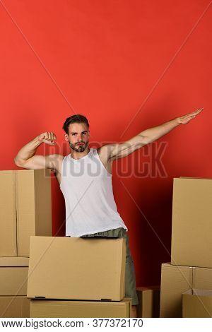 Guy On Red Background Pretending To Fly Like Superhero
