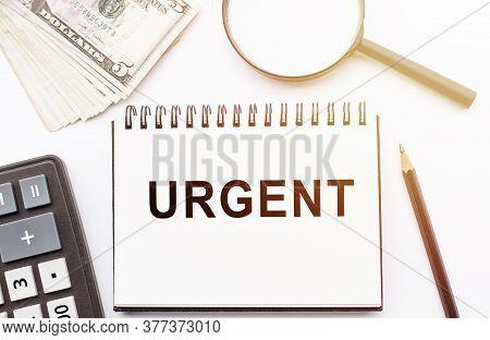 Urgent Sticky Written On Notebook. Urgent Business Concept