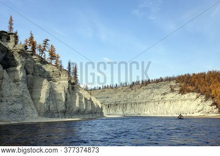 Landscape On The Siberian Taiga River During Rafting In September. Riverbed Moiyerocan Fall During T