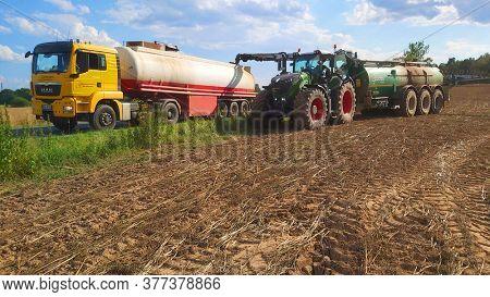 Dobrany / Czech Republic - July 21, 2020: Farmer use liquid manure for organic growing.  Fertilization in agriculture. Environmentally friendly farming in Czech Republic, European Union.