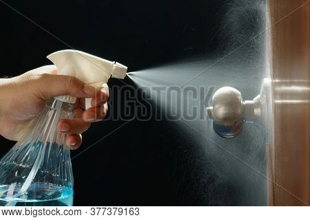 Cleaning Door Knob With Alcohol Spray For  Covid-19 (coronavirus) Prevention.
