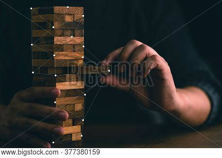 Business Man Try To Build Wood Block On Wooden Table And Black Background Business Organization Star