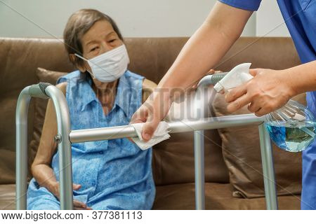 Caregiver Spray Alcohol And Cleanning A Walker Aids For Elderly At Home