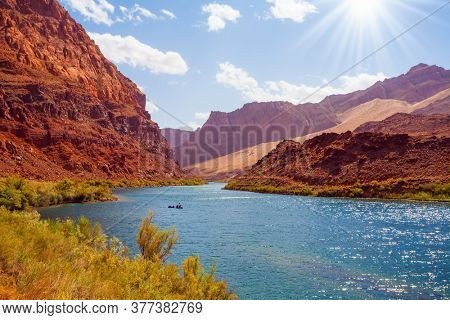 Amazing wildlife. Stormy wide river with rapids and banks of red sandstone. Lee's Ferry is a historic boat ferry across the Colorado River. USA, Arizona. The concept of extreme and photo tourism