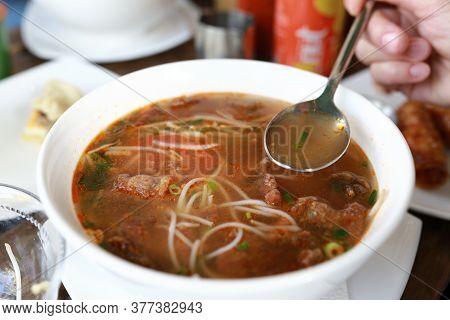 Person Eating Bun Ca Vermicelli Fish Soup