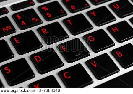 Close Up View Of A Modern Laptop Computer Keyboard Key With Red Buttonss. Pc Computer Keyboard Close
