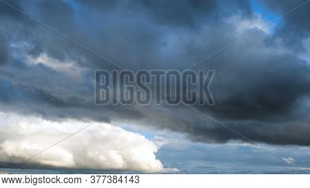 Birds Flying Against Stormy Clouds On A Summer Day. Concept. Bottom View Of Heavy Beautiful Clouds F
