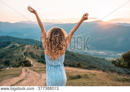 Woman Traveler Posing With Raising Arms Relaxing On Viewpoint. Perfect Slim Body Woman. Portrait Of