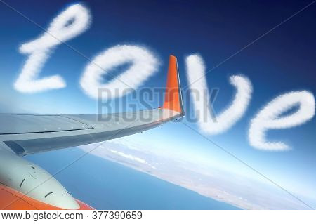 Airplane Wing Over The Blue Strait In The Desert. Concept To Illustrate The Love Of Airplane Travel