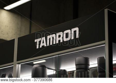 Krasnoyarsk, Russia, July 20, 2020: Tamron Logo On A Shop Window On A Black Background