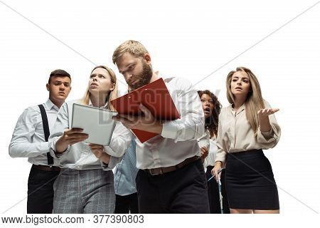 Decisions. Nervous Tensioned Investors Analyzing Crisis Stock Market With Charts On Their Gadgets. D