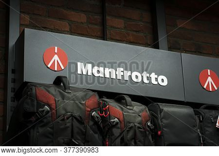 Krasnoyarsk, Russia, July 20, 2020: Manfrotto- Company Logo On The Rack With Accessories And Backpac