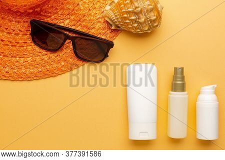 Set Of Sunblock Moisturizer And Spray To Protect From Sunlight On The Beach. Summer Vacation Cosmeti