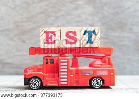 Red Fire Truck Hold Letter Block In Word Est (abbreviation Of Established, Estimated, Eastern Time Z