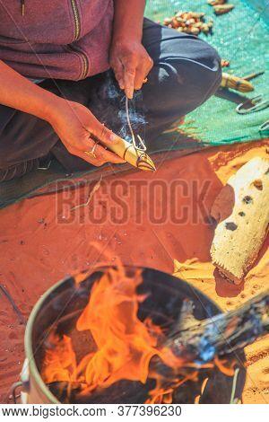 Kings Creek Station, Northern Territory, Australia - Aug 21, 2019: Australian Aboriginal Woman Shows