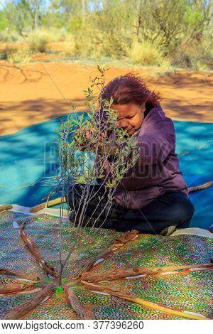 Kings Creek Station, Northern Territory, Australia - Aug 21, 2019: Australian Aboriginal Woman Makin