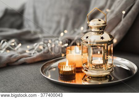 Golden Lantern And Burning Candles On A Metal Tray. Traditional Decor For Muslim Holidays. Eid Al Ad