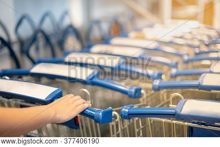 Female Hand Pushing The Trolley Cart Shopping The Decorate Funiture For Interior Inside The House In