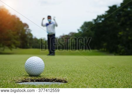 Blurred Golfer Playing Golf In The Situation Of The Viris Covid 19 At Beautiful Golf Course In The E