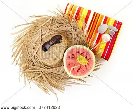 A half watermelon, straw hat, sunglasses, towel, pebbles. Isolated on white.