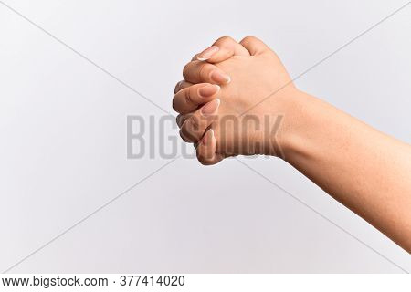 Hand of caucasian young woman praying with both hands clasped, fold fingers religious gesture