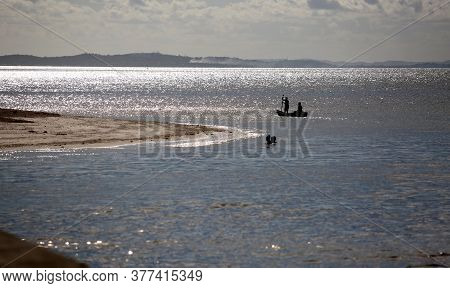 Salvador, Bahia / Brazil - October 25, 2017: Man Rowing His Boat Across The Itapagipe Peninsula In T