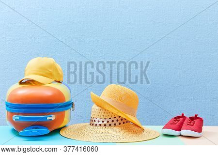 Family Trip. Travelling Background. Family Holiday. Summer Time. Suitcase, Sun Hats And Sneakers On
